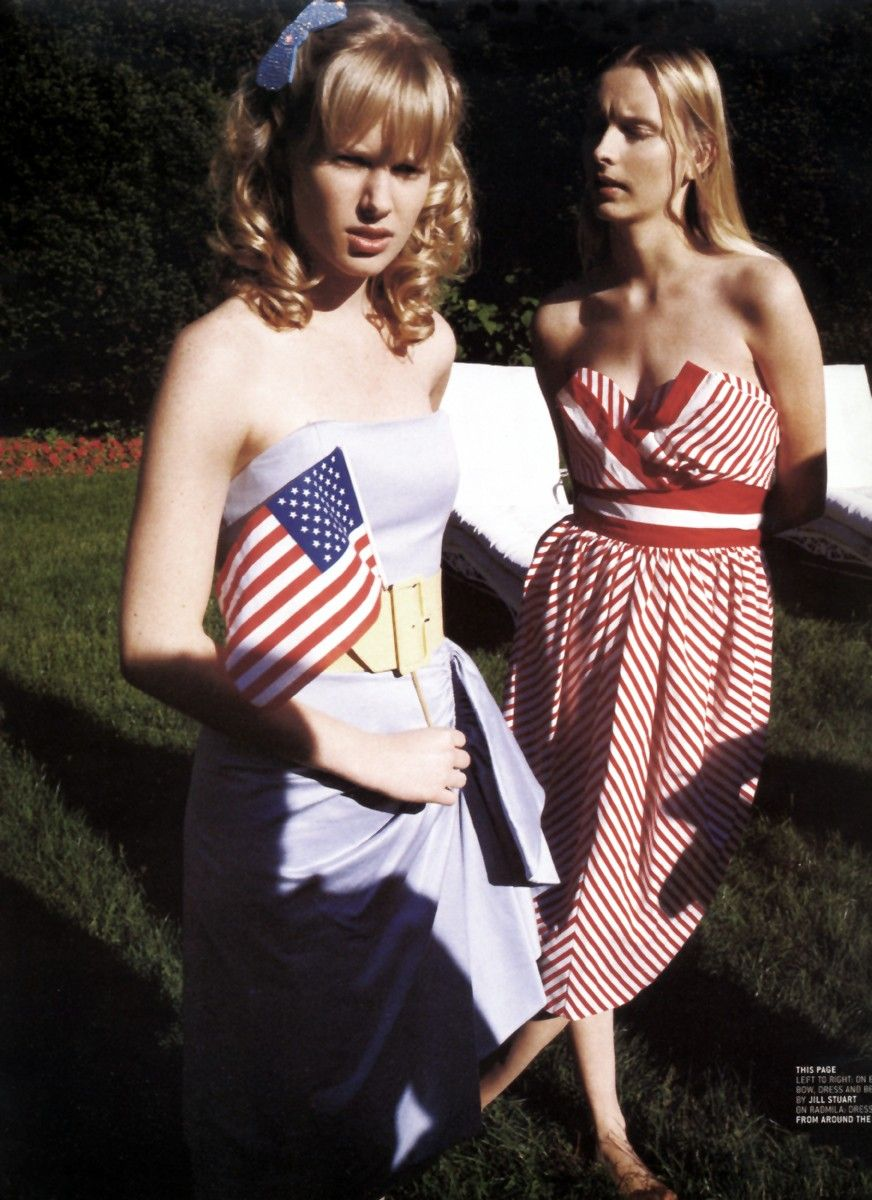 Models holding tiny American flags