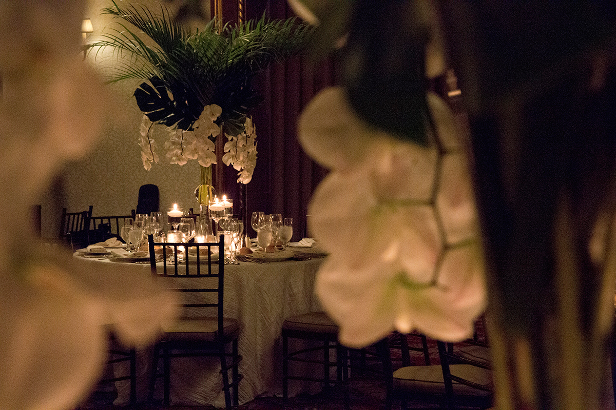 Tables, place settings and orchids at the New York Athletic club shot with DSLR by Angela Cappetta fine art wedding photographer.