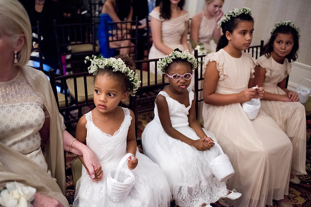 Flower girls watch on at a ceremony at the New York Athletic club shot with DSLR by Angela Cappetta fine art wedding photographer.