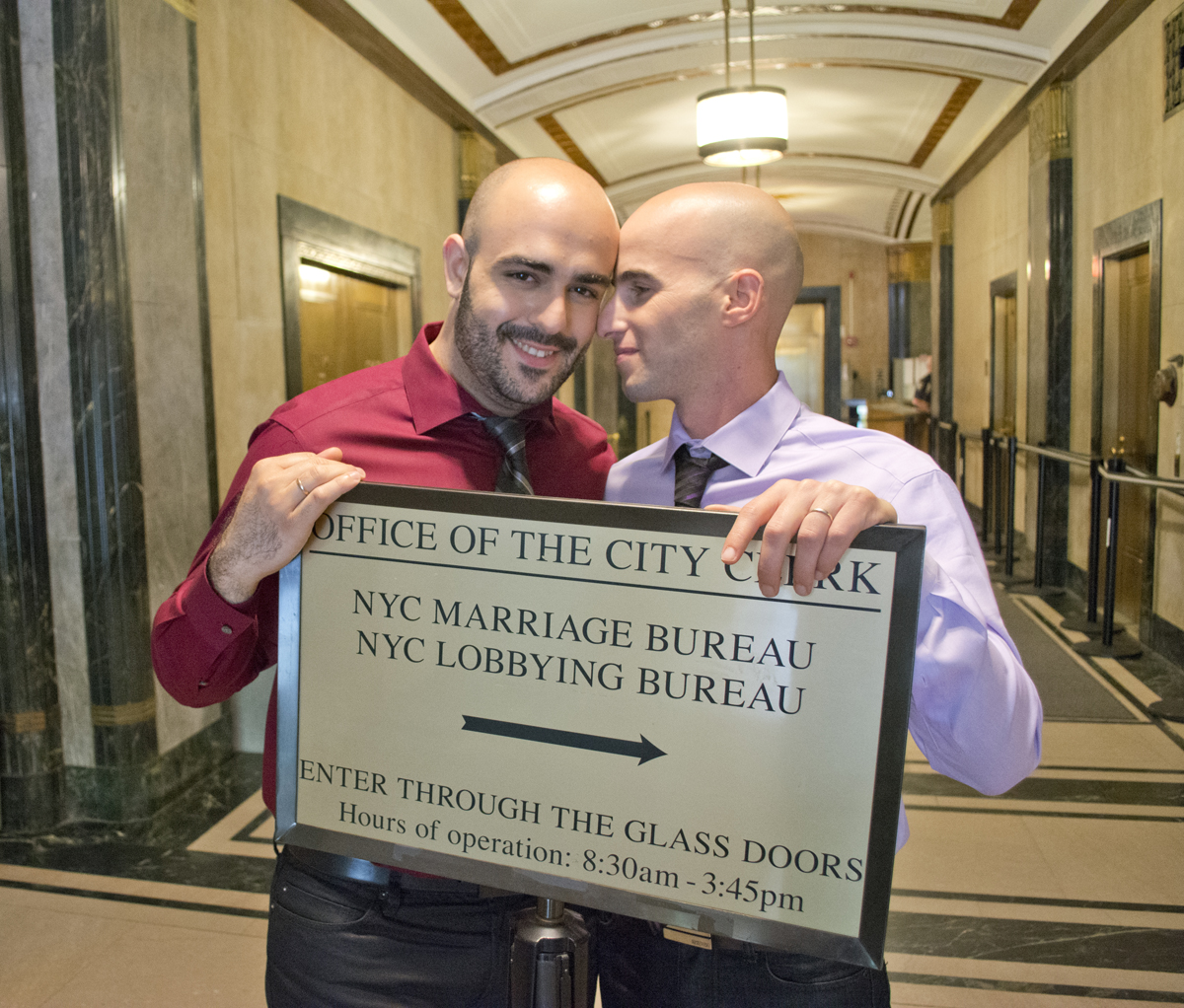 2 grooms pose at City Hall Marriage Bureau NYC