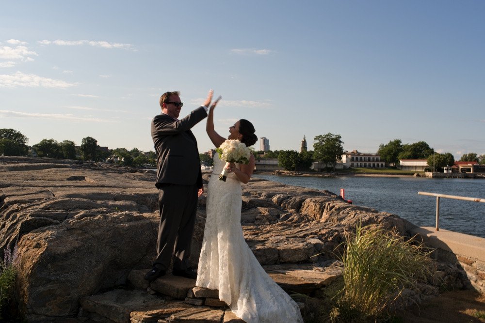Westchester Country Club Wedding Couple High FIves near the Bay