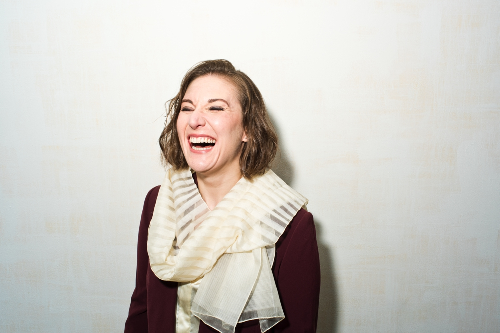 Portrait of NYC Psychiatrist MD Lara Cox Laughing in 3/4 view