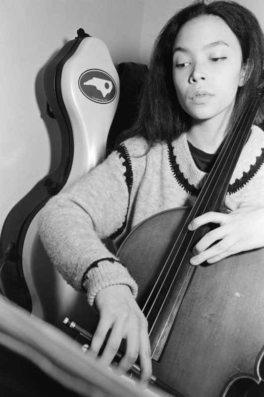 Cello player shot in real black and white film shot by NYC portrait photographer Angela Cappetta wit medium format film.