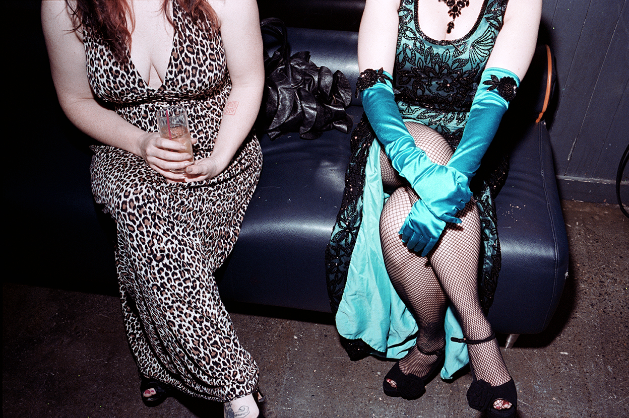 Two wedding guests dressed in burlesque dresses at the bride's request. NYC 2014.