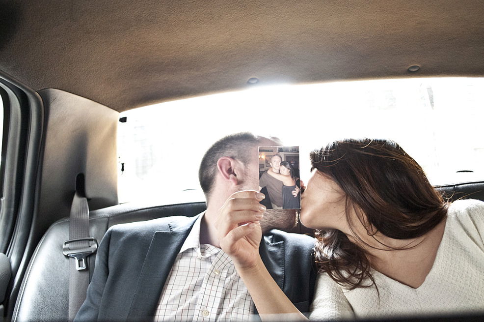 Couple smooches in a cab after their NYC CIty Hall wedding. Shot with DSLR by Angela Cappetta.