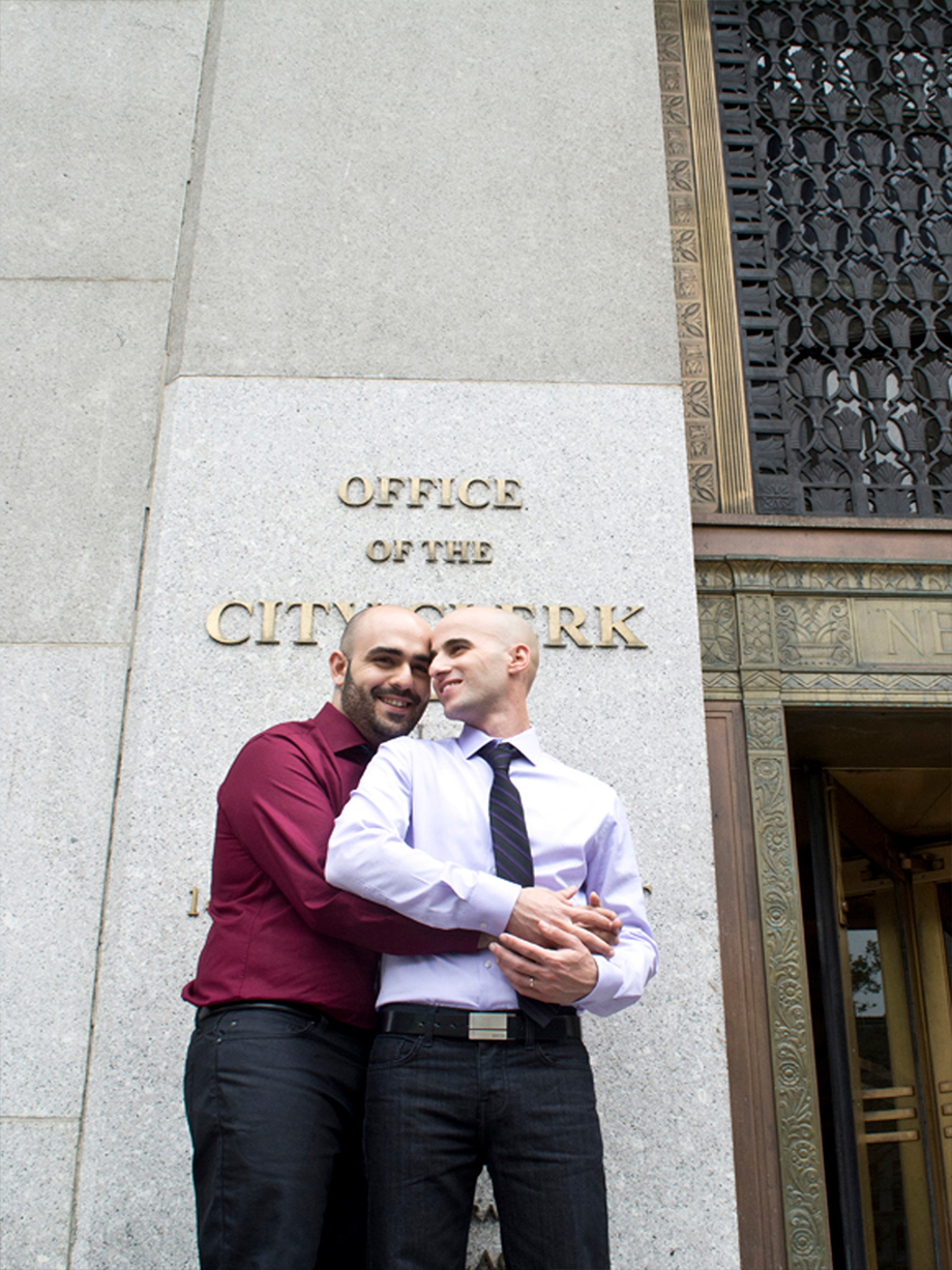 Two grooms pose for their NYC City Hall wedding photography shot by NYC City Hall Wedding photographer Angela Cappetta