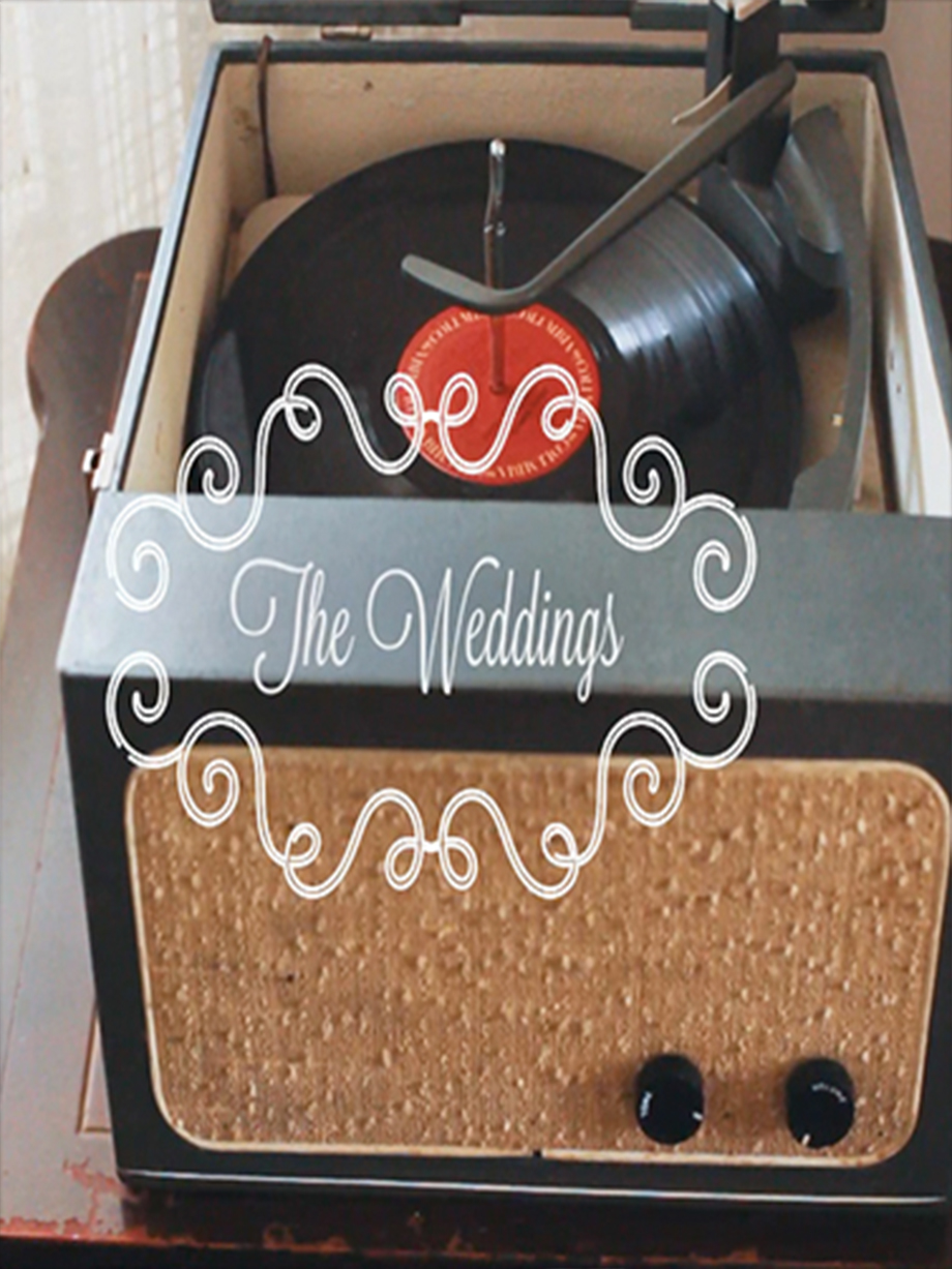 Wedding Sizzle Reel thumbnail showing an analog record player directed and produced by fine art wedding photographer Angela Cappetta.