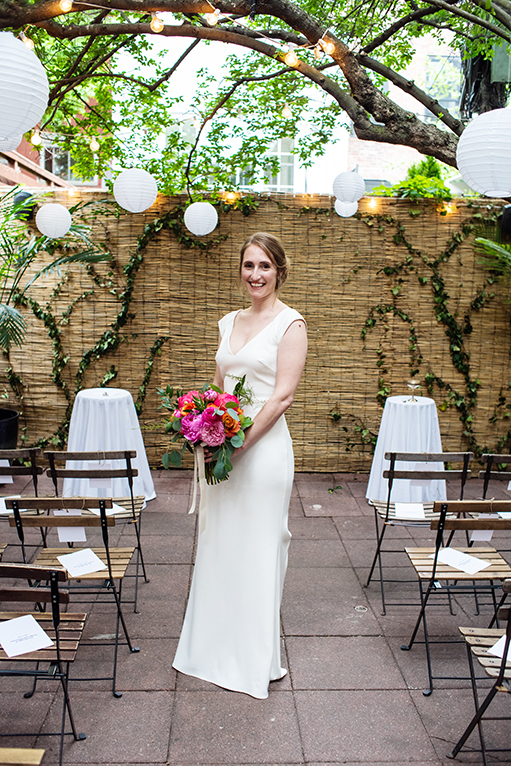 Bride's stands in aisle with bouquet at a Brooklyn Bistro wedding shot by NYC Wedding photographer Angela Cappetta