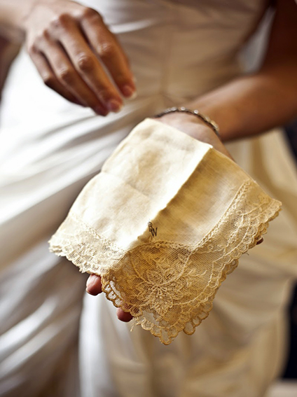 Bride holds out family handkerchief shot by NYC wedding photographer Angela Cappetta with DSLR