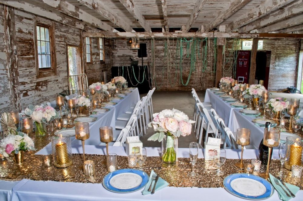Glam style table set for dinner in a rustic barn shot by destination wedding photographer Angela Cappetta